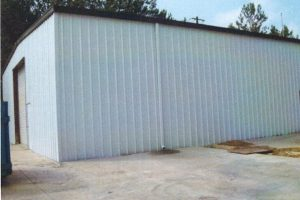 Warehouse Siding and Downspout Repair